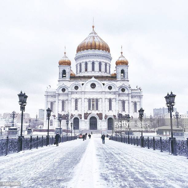 Snow Covered Road Leading Towards Cathedral Of Christ The Saviour Against Sky