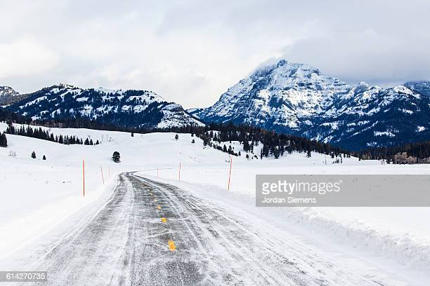 snow covered road. - bozeman stock pictures, royalty-free photos & images