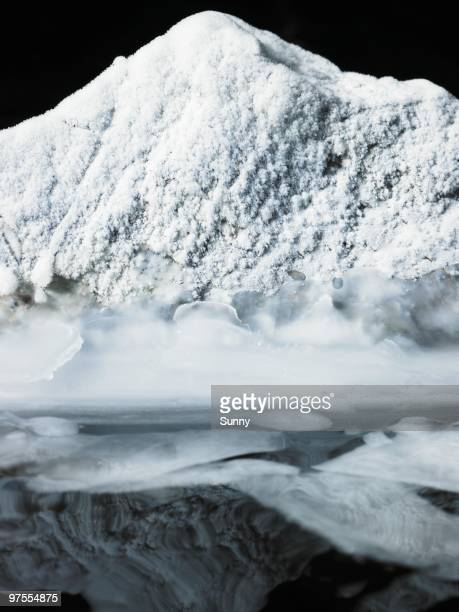 snow covered rock - climat stock pictures, royalty-free photos & images