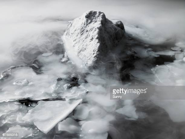 snow covered rock surrounded by ice - climat stock pictures, royalty-free photos & images