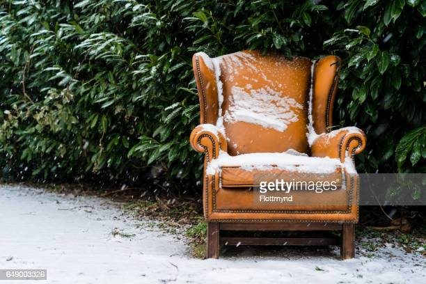 Snow covered seat along the roadside