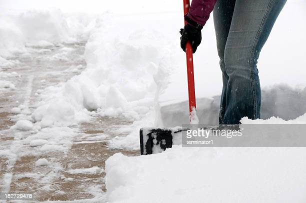 snow covered sidewalk - snow shovel stock photos and pictures