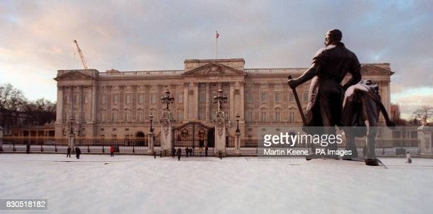 A snow covered statue stands guard outside London's Buckingham Palace the official London residence of The Queen after overnight snow fell in the...