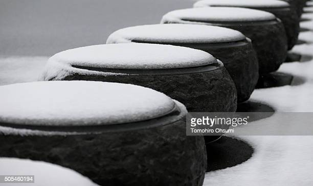 Snow covered stone bollards are seen outside the Imperial Palace on January 18 2016 in Tokyo Japan The first heavy snowfall of the season reached 6...