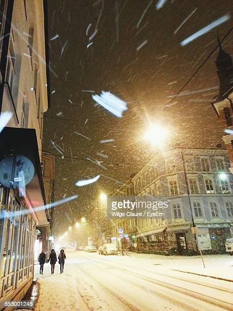 Snow Covered Street Amidst Buildings