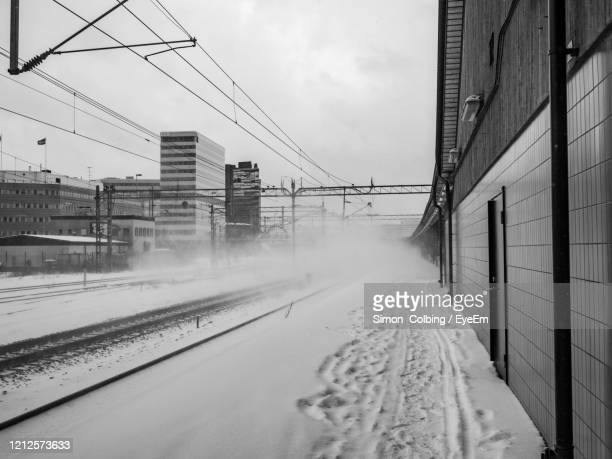 snow covered train platform - colbing stock pictures, royalty-free photos & images
