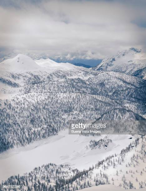 snow covered valley among mountains