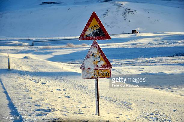 Snow Covered Warning Road Sign at Reykjahlid area of Myvatn North Iceland