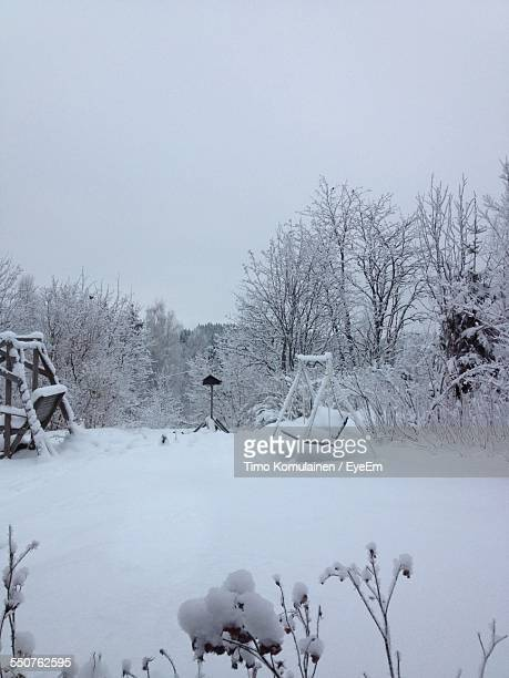 Snow Covered Yard In Clear Sky
