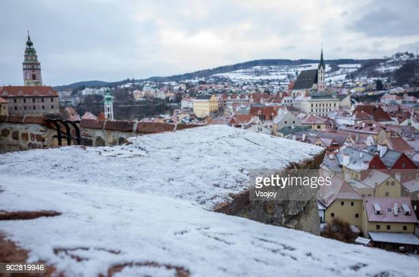 snow covering český krumlov, czech republic - cesky krumlov castle stock photos and pictures