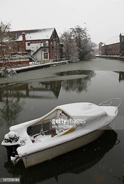 Snow covers a boat mooresd on the River Medway in Tonbridge southeast England on December 1 2010 Britain's transport links with the rest of the world...