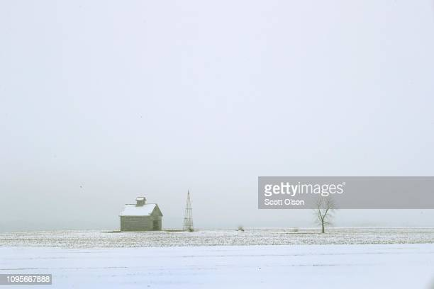 Snow covers a farm field on January 17 2019 near Ottawa Illinois Farmers who rely on Farm Service Agency loans to meet operating expenses buy seed...