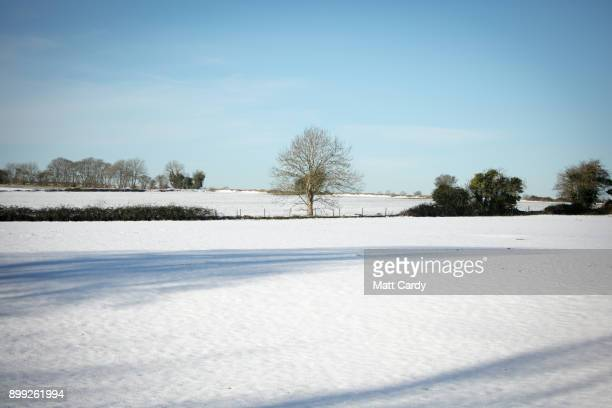 Snow covers a field on December 28 2017 near Bath England A cold spell has hit Britain causing travel disruption at some UK airports overnight