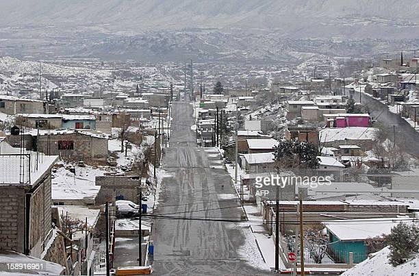 Snow covers Ciudad Juarez Mexico on January 3 2013 Snow and temperatures below zero are rare in this area AFP PHOTO/Jesus Alcazar