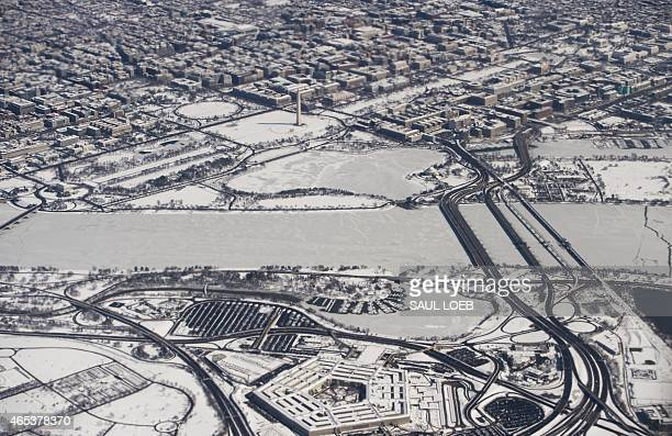Snow covers downtown Washington DC including the Lincoln Memorial Washington Monument and US Capitol on the National Mall the White House and the...