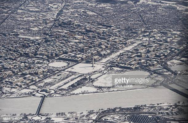 Snow covers downtown Washington DC including the Lincoln Memorial Washington Monument and US Capitol on the National Mall and the White House in this...