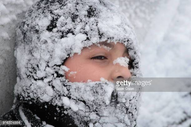 Snow covers eightyearold Eduardo Chavez after a morning of sledding in Humboldt Park following a storm that dumped more than 7 inches of snow on...
