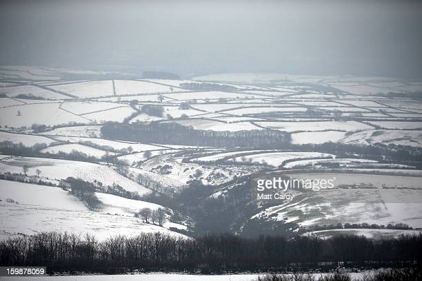 Snow covers fields near to Simonsbath on January 22, 2013 on Exmoor, England. Snow and ice is continuing to cause disruption to some parts of the UK...