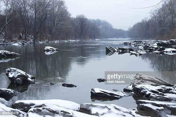 Snow covers rocks on the Schuylkill River on the first snowfall of the year December 17 2016 in Philadelphia Pennsylvania