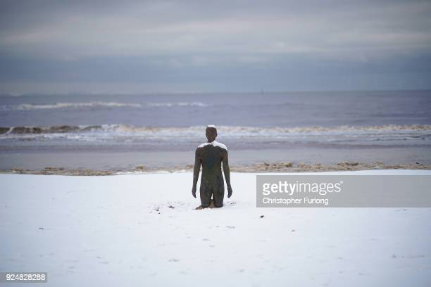Snow covers the beach and a statue at Antony Gormley's art installation 'Another Place' at Crosby Beach on February 27 2018 in Liverpool United...