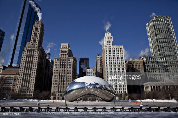 Snow covers the Cloud Gate sculpture known as the Bean at Millennium Park in Chicago Illinois US on Wednesday Jan 30 2019 Bitter cold is taking hold...