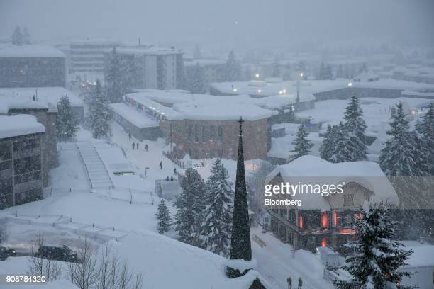 Snow covers the Congress Center during heavy snowfall ahead of the World Economic Forum in Davos Switzerland on Monday Jan 22 2018 World leaders...