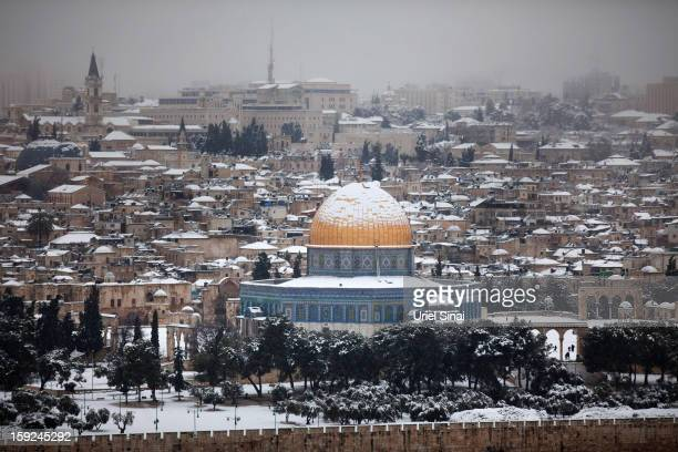 Snow covers the Dome of the Rock at the AlAqsa mosque compound on January 10 2013 in the old city in east Jerusalem Israel
