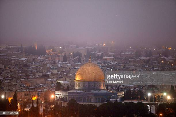 Snow covers the Dome of the Rock at the AlAqsa mosque compound on January 8 2015 in Jerusalem Israel A major storm that reached Israel from Eastern...
