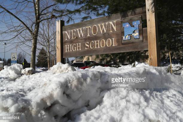 Snow covers the entrance of Newtown High School on March 14, 2018 in Sandy Hook, Connecticut. Students at the school, near the site of the Sandy Hook...