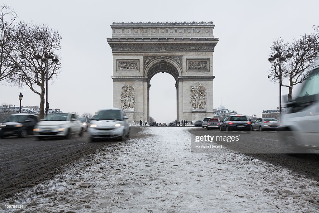 Snow covers the ground around the Arc de Triomphe on January 19, 2013, in Paris, France. Heavy snowfall fell throughout Europe and the UK causing travel havoc and white layers of pretty scenery.