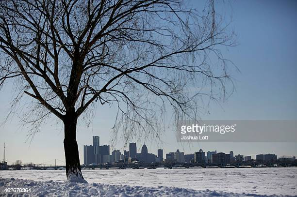 Snow covers the ground as the Detroit skyline stands in the background February 2 2015 in Detroit Michigan Detroit received over a foot of snow...