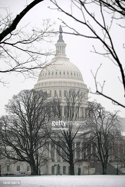 Snow covers the ground outside the US Capitol in Washington DC US on Monday March 25 2013 An early spring snowstorm tied up air traffic along the US...