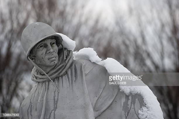 Snow covers the Korean War Memorial on the National Mall in Washington DC on January 27 the day after a snowstorm dropped 58 inches of snow in the...
