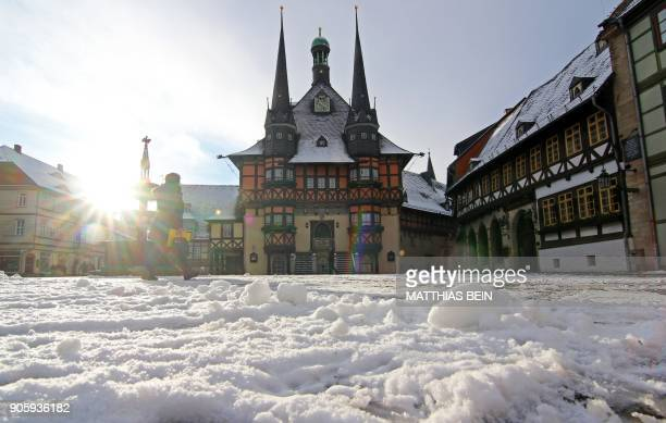 Snow covers the market place and the town hall of Wernigerode in the Harz region central Germany on January 17 2018 / AFP PHOTO / dpa / Matthias Bein...