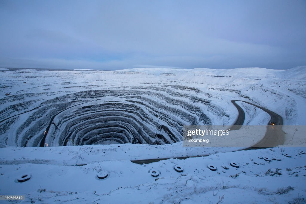 Snow covers the open pit of the Udachny diamond mine operated by OAO Alrosa in Udachny, Russia, on Sunday, Nov. 17, 2013. OAO Alrosa, the world's largest diamond producer, raised about $1.3 billion in an oversubscribed share sale from investors including Oppenheimer Funds Inc. and Lazard Ltd.'s asset-management unit, First Deputy Prime Minister Igor Shuvalov said. Photographer: Andrey Rudakov/Bloomberg via Getty Images