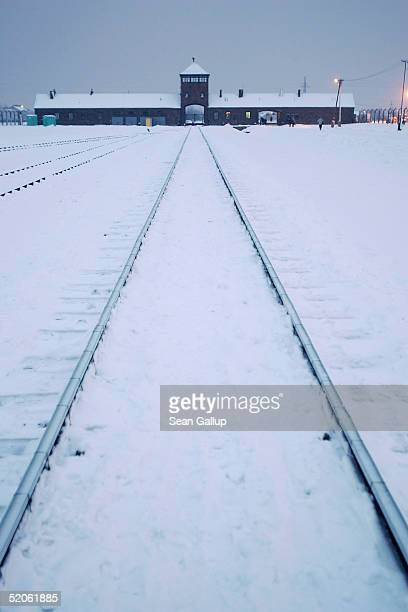 Snow covers the railroad tracks leading from the main entrance into the former concentrations camp known as Auschwitz II or Birkenau January 25 2005...