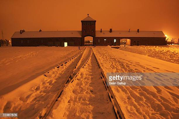 Snow covers the railroad tracks leading from the main entrance into the former concentrations camp known as Auschwitz II, or Birkenau, January 25,...