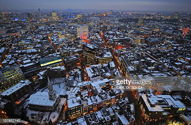 Snow covers the rooftops of buildings in central London on December 20 2010 Thousands of stranded travellers faced a nervy battle to get home for...