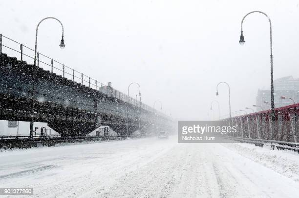 Snow covers the Williamsburg Bridge during a massive winter storm on January 4 2018 in New York City As a major winter storm moves up the Northeast...