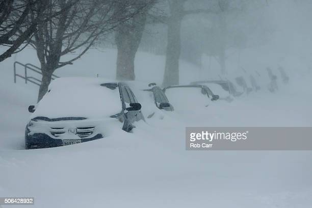 Snow covers up cars on a side street on January 23 2016 in Baltimore Maryland Heavy snow continued to fall in the the MidAtlantic region causing...