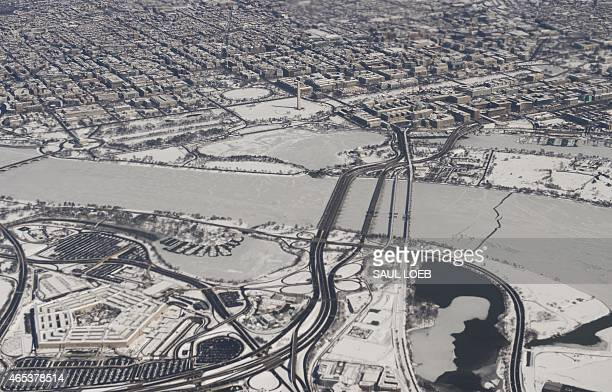 Snow covers Washington DC including the Lincoln Memorial Washington Monument and US Capitol on the National Mall the White House and the Pentagon as...