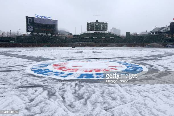 Snow covers Wrigley Field the morning of the Chicago Cubs home opening game against the Pittsburgh Pirates on Monday April 9 2018 in Chicago Ill The...