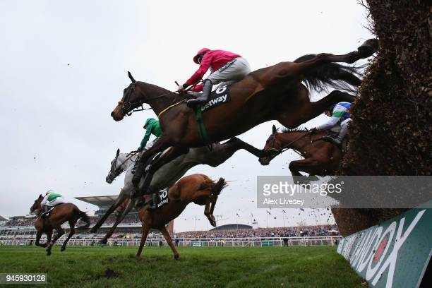 Snow Falcon ridden by Sean Flanagan clears a fence during the Betway Mildmay Novices' Chase on Ladies Day at Aintree Racecourse on April 13 2018 in...