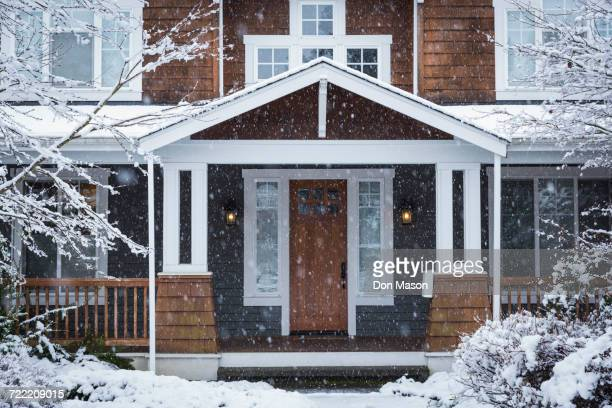 snow falling near house - winter house stock pictures, royalty-free photos & images