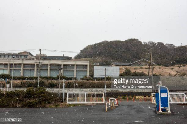 Snow falling on the beach in Kamakura in Japan