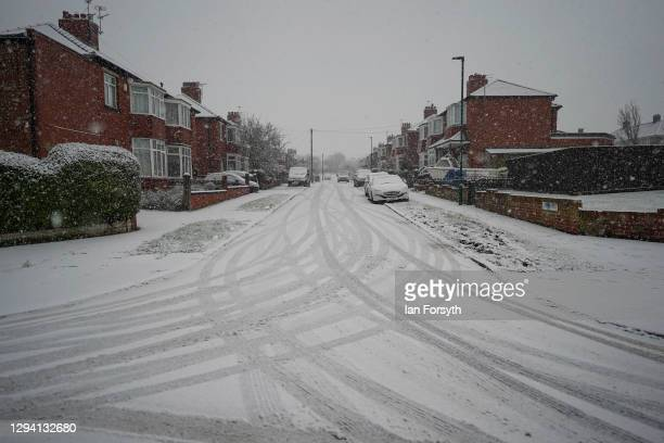 Snow falls and covers the roads in Saltburn on the North Yorkshire coast on January 02, 2021 in Saltburn By The Sea, United Kingdom. Cold weather...
