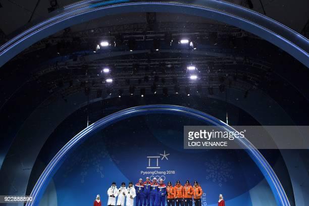 Snow falls as South Korea's silver medallists Lee Seung-Hoon, Chung Jaewon, Kim Min Seok and Joo Hyong-Jun, Norway's gold medallists Havard Bokko,...