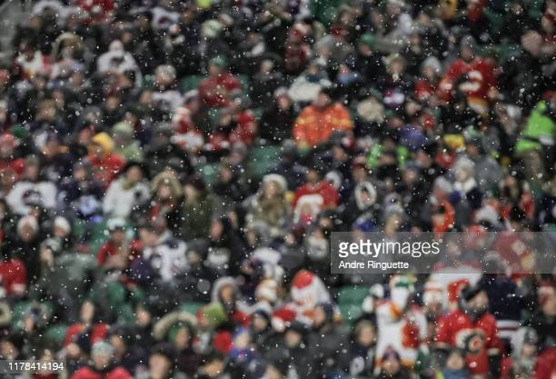 Snow falls as the Calgary Flames take on the Winnipeg Jets during the 2019 Tim Hortons NHL Heritage Classic at Mosaic Stadium on October 26, 2019 in...