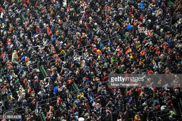Snow falls as the Calgary Flames take on the Winnipeg Jets during the 2019 Tim Hortons NHL Heritage Classic at Mosaic Stadium on October 26 2019 in...