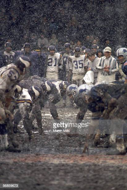 Snow falls as the Minnesota Vikings faceoff against the Detroit Lions at the line of scrimmage during a game circa late 1960's